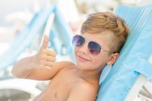 The Boy On A Sunny Beach Lies ...