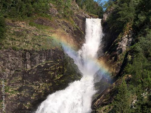 Poster Watervallen Rainbow over waterfall