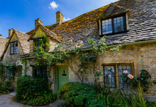 Medieval Cotswold Stone Cottages Of Arlington Row In The Village Of Bibury, England