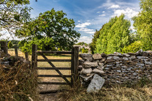 Wooden Gate And Stone Wall Alo...
