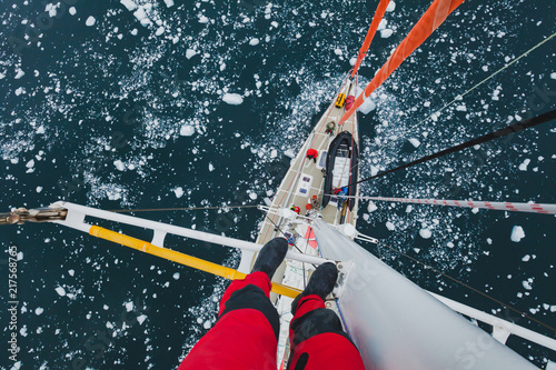 Obraz na plátně sailing boat in Antarctica, extreme dangerous  travel selfie, person feet standi