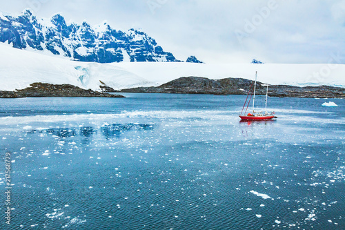 Poster Antarctique sailing boat in Antarctica, travel by yacht cruise, beautiful remote tourism destination