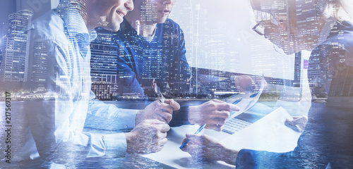 Fotografía  business team of coworkers working on startup in office, banner double exposure