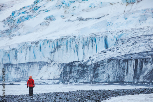 obraz PCV person walking near big melting glacier in Antarctica, beautiful landscape of Livingston Island in South Shetland