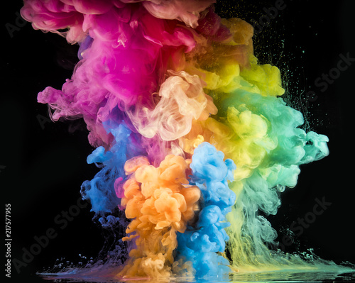 Garden Poster Smoke Colorful rainbow paint drops from above mixing in water. Ink swirling underwater.