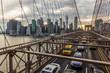 Traffic on Brooklyn Bridge at sunset (New York, USA)