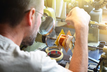 A Man Producing An Electrical ...
