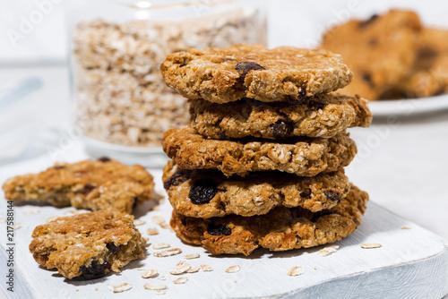 Tuinposter Koekjes homemade oatmeal cookies with raisins on wooden board