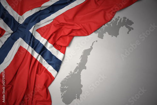 Photo  waving colorful national flag and map of norway.