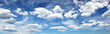 Leinwandbild Motiv white fluffy clouds on blue sky in summer on sunny day