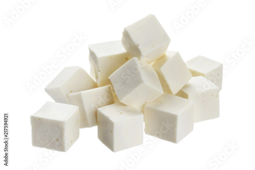Heap of diced feta cubes isolated on white background