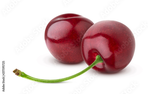 Two fresh cherries isolated on white background