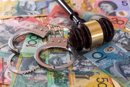 Judge's gavel with handcuffs on australian dollars Canvas Print