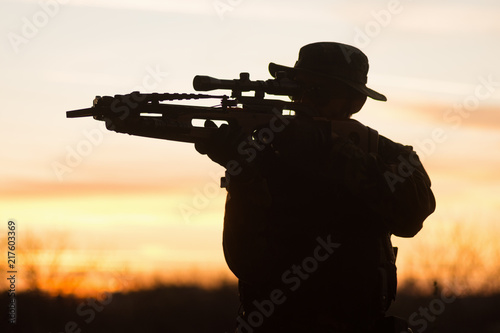 Canvas Print man with crossbow silhouette