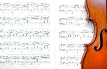 Violin On Sheet Music. Close U...
