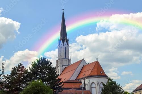 fototapeta na lodówkę VIENNA, AUSTRIA - JUNE 19, 2018: Beautiful rainbow over Catholic parish church Maria Hietzing