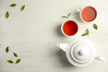Flat Lay Composition With Delicious Tea On Wooden Background