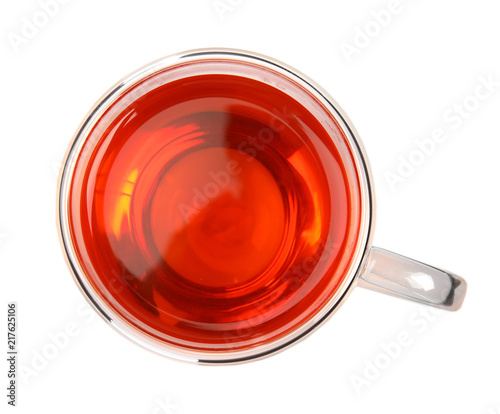 Glass cup of black tea on white background, top view