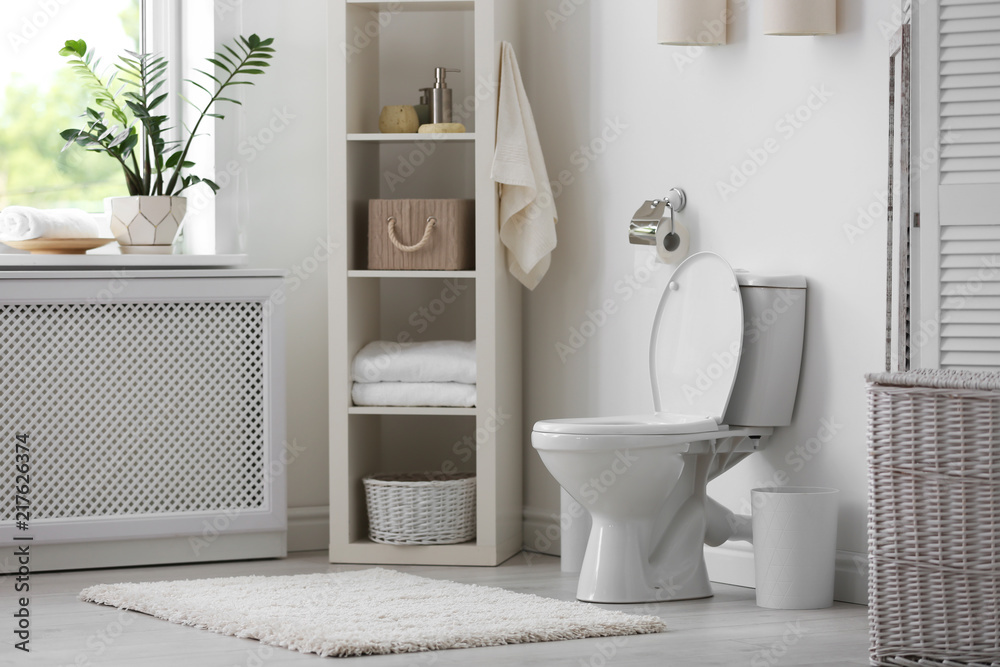 Fototapeta Toilet bowl in modern bathroom interior