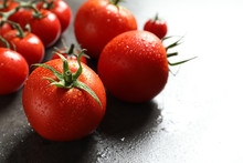 Tasty Juicy Tomatoes On Grey Background, Closeup