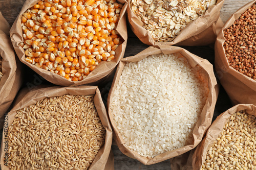 Bags of different cereal grains, top view