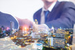 Double exposure concept. Investor business handshake with city night background. Businessman shaking hands using as business partnership success concept, Teamwork concept, Investment, Growth.