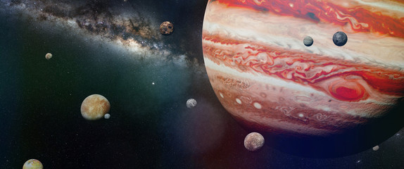 planet Jupiter with some of the 69 known moons with the Milky Way galaxy
