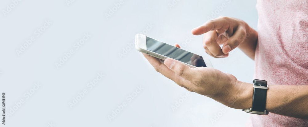 Fototapety, obrazy: Male hand  holding smartphone,mobile with copy space on banner size  background.panoramic