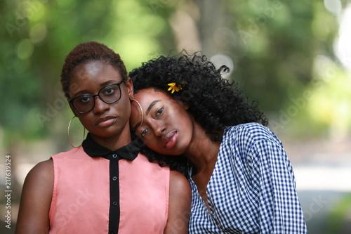Fotografering  Ethnic lesbian couple in park