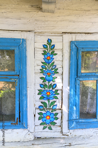 Fotografering  Painted old wooden cottage decorated with a hand painted colorful floral motives