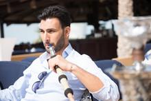 Expat Man Smoking Sheesha At R...