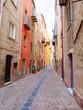 View of the beautiful, colorful, narrow street in Bosa. province of Oristano, Sardinia,