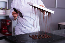 Chocolate Sweets. Professional Chocolatier Feeling Very Busy While Making Nice Little Chocolate Sweets