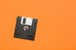 canvas print picture - floppy data storage diskette on orange background with copy space