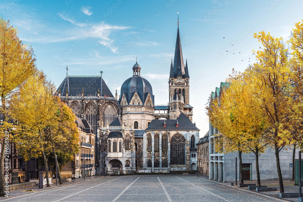 Fototapety, obrazy: German cathedral in Aachen during fall with yellow leafs at trees with blue sky