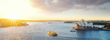 Cityscape Of Sysney Harbour With Morning Sunrise Moment And Boat In The Sea