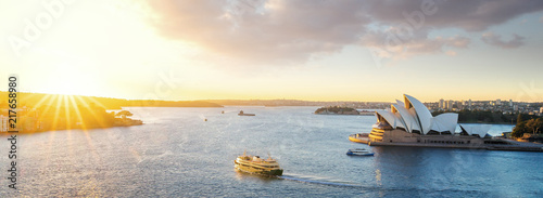 Canvas Prints Sydney Cityscape of Sysney harbour with morning sunrise moment and boat in the sea