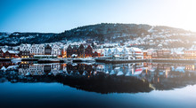 Panoramic View. Yachts Moored In Harbour Of Bergan, Norway. Brightly Lighted Houses Near Port Of Bergan During Christmas