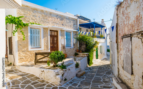 фотография Small narrow street of Greek village of Lefkes with houses made of stone with sm