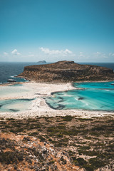 View of the beautiful beach in Balos Lagoon, and Gramvousa island on Crete, Greece. Sunny day, blue Sky with clouds.