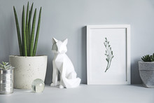 Gray Modern Space With Mock Up Poster Frame, Fox Figures And Plant. Minimalistic Desk In Gray Interior.