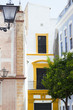 Architectural detail. Picturesque Seville street with traditional yellow-white houses
