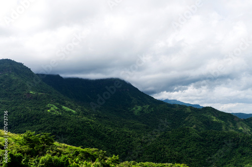 Foto op Aluminium Wit Peak mountain cover by cloud in mist in a scenic landscape view
