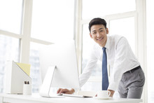Cheerful Young?businessman Working In Office