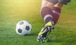 Leinwanddruck Bild - Running soccer player on grass