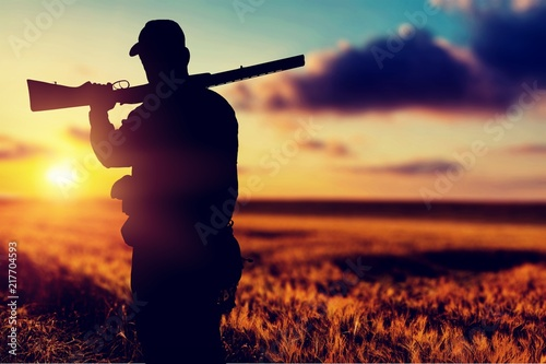 Male Hunter with Rifle on natural background Canvas-taulu