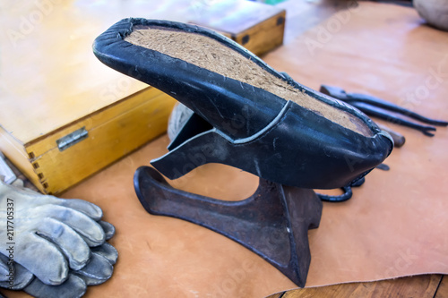 Photo Set of leather craft tools on wooden background