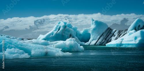 Fotografie, Obraz  Scenic view of icebergs in Jokulsarlon glacier lagoon, Iceland, in summer