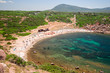 Some sunbathers lying in the sun on the beach of Porticciolo in Sardinia, Italy.