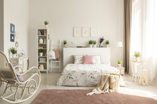 White Bedroom Interior With Dirty Pink Carpet, Rocking Chair, Window With Drapes And King-size Bed In The Real Photo